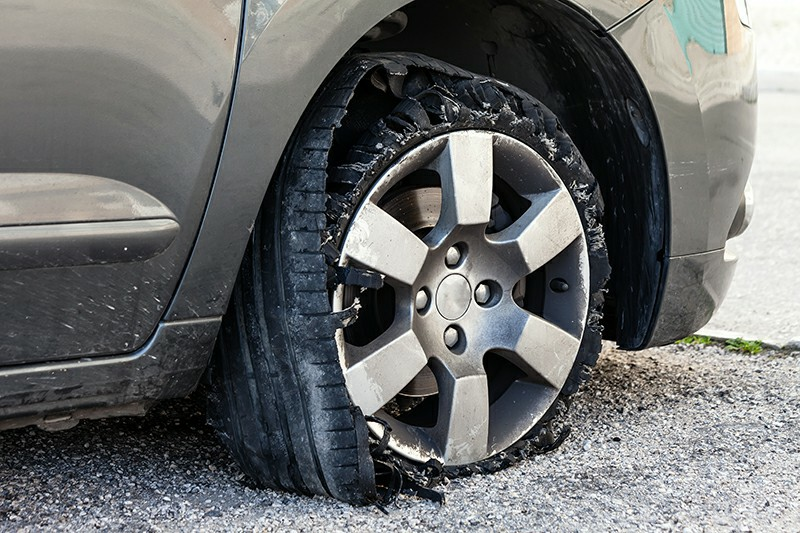 A severely damaged tire